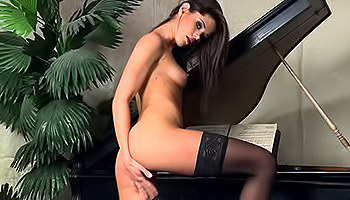 Caprice - Brunette hottie gets her cunt wet on a piano