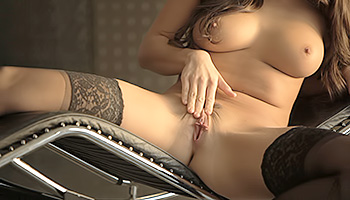 Teal Conrad - Elegant brunette in black stockings makes her muff wet