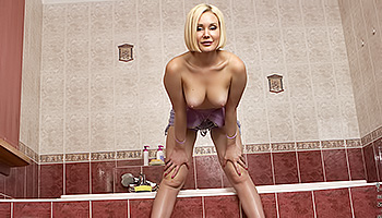 Mila Nubiles - A bleached blonde with round tatas gets off in the shower