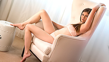 Lara Brookes - A slim slut masturbates hard in a recliner