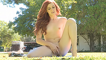 Elle FTV - Cheerful red-head dancing naked in a her garden