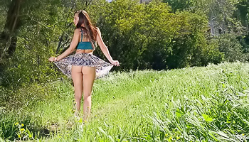 Hot lady gets naked in the field outdoors