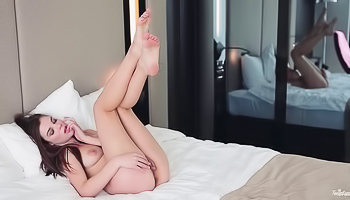 Dakota - Skinny little babe is filmed while naked on the bed