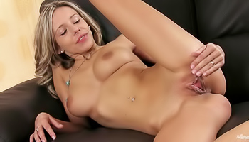 Tracy - Blonde is giving herself a massaged on the couch